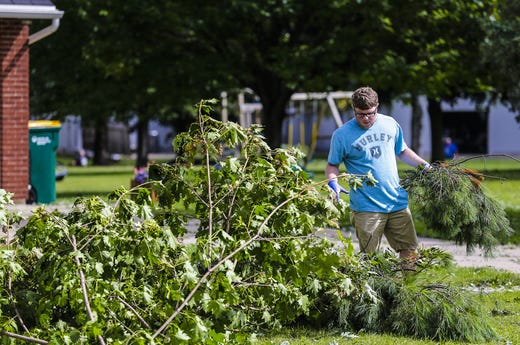 Nick Fenrich piled branches in front of his house Wednesday, August 29, 2018 at 516 Taylor Street in Waupun, Wisconsin. Heavy weather hit the Waupun area, causing major damage on Tuesday afternoons and affecting a potential tornado in some places. Doug Raflik / USA TODAY NETWORK-Wisconsin