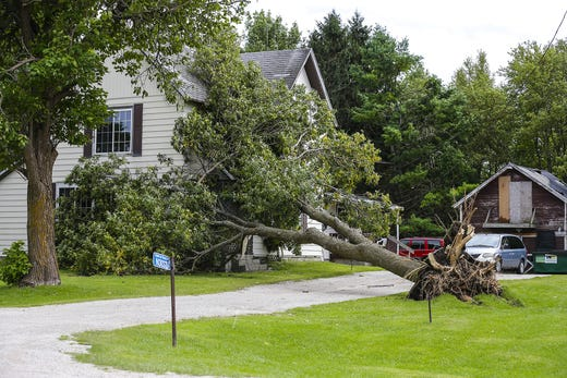 A tree lies on a house Wednesday, August 29, 2018 at N3037 South Frontage Road near Waupun, Wisconsin. Heavy weather hit the Waupun area, causing major damage on Tuesday afternoons and affecting a potential tornado in some places. Doug Raflik / USA TODAY NETWORK-Wisconsin