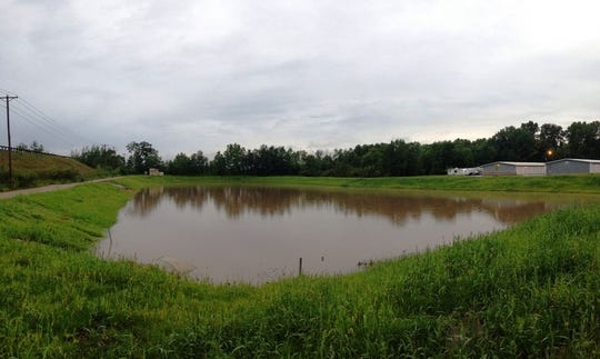 A pond along Northland Avenue in Appleton holds runoff from Tuesday's storm. The water entered the pond in a rush but will exit at a steady, manageable rate.