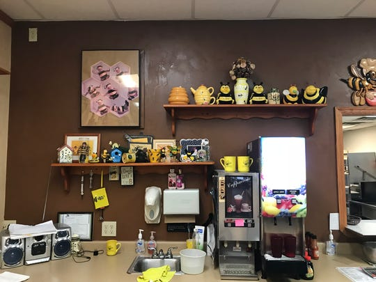 The Queen Bee's back counter is filled with bee memorabilia.