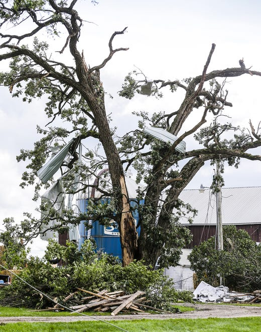 Sheet metal from a nearby post throws down a tree Wednesday, August 29, 2018, at W12072 Hemp Road near Waupun, Wisconsin. Heavy weather hit the Waupun area, causing major damage on Tuesday afternoons and affecting a potential tornado in some places. Doug Raflik / USA TODAY NETWORK-WISCONSIN