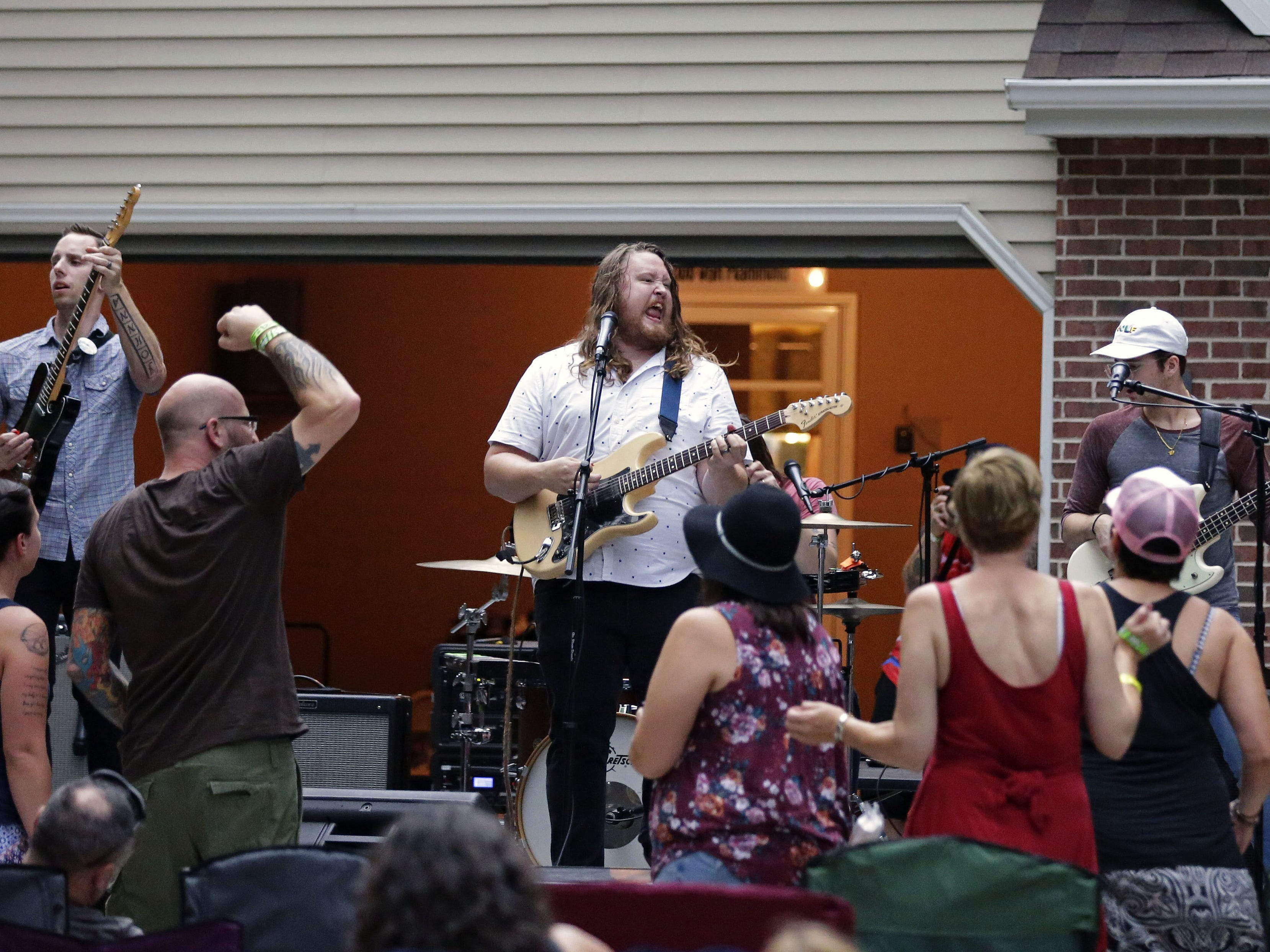 Me Like Bees perform in the driveway of Todd Van Hammond in late August. The Appleton man hosted a Sunday afternoon block party featuring three bands last month.