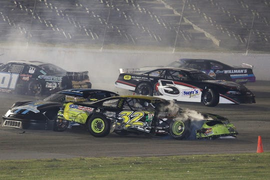 Cars get caught up in a wreck at Wisconsin International Raceway in Kaukauna last Thursday, including the car of Bryan Monday (top left).