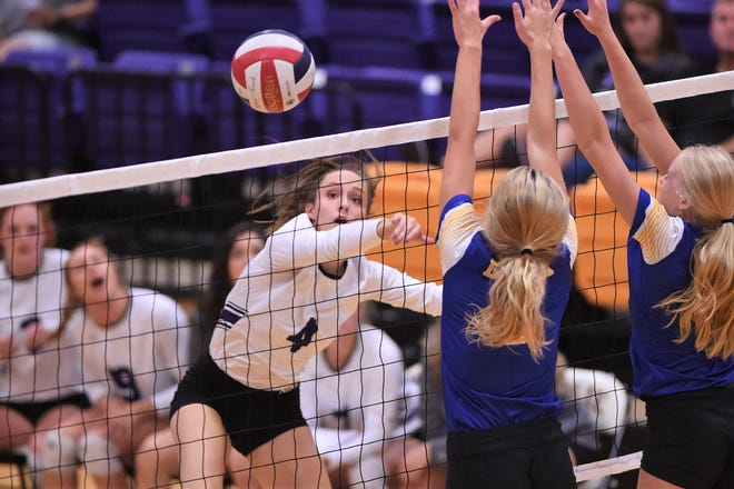 Wylie's Karis Christian (4) watches her shot go over the net during the Lady Bulldogs' match against Brock at Bulldog Gym on Tuesday, Aug. 28, 2018. The Lady Bulldogs won 3-1.