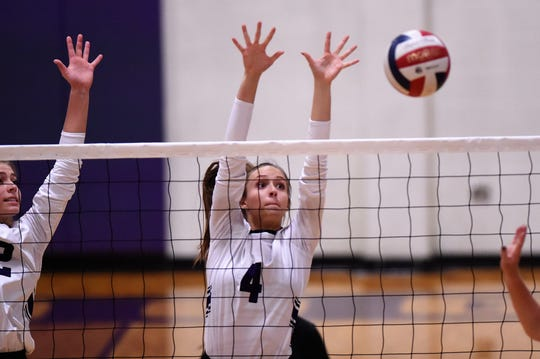 Wylie's Karis Christian (4) reaches for a block during the Lady Bulldogs' match against Brock at Bulldog Gym on Tuesday, Aug. 28, 2018. The Lady Bulldogs won 3-1.
