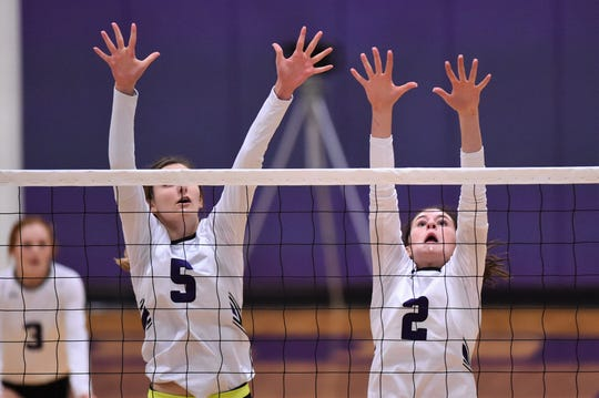 Wylie's Lily Kate Doby (5) and Avery Wimberly (2) jump for a block during the Lady Bulldogs' match against Brock at Bulldog Gym on Tuesday, Aug. 28, 2018. The Lady Bulldogs won 3-1.