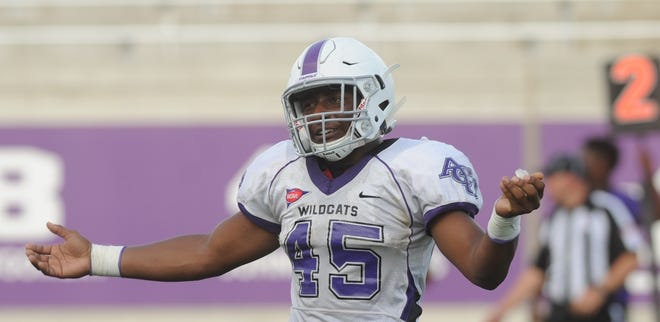 ACU linebacker Qua'Shawn Washington reacts after a play during the Wildcats' scrimmage Aug. 18 at Wildcat Stadium. Washington will start at linebacker for the Wildcats in Saturday's game against Baylor, after playing running back for the first time in his career last season as a freshman.