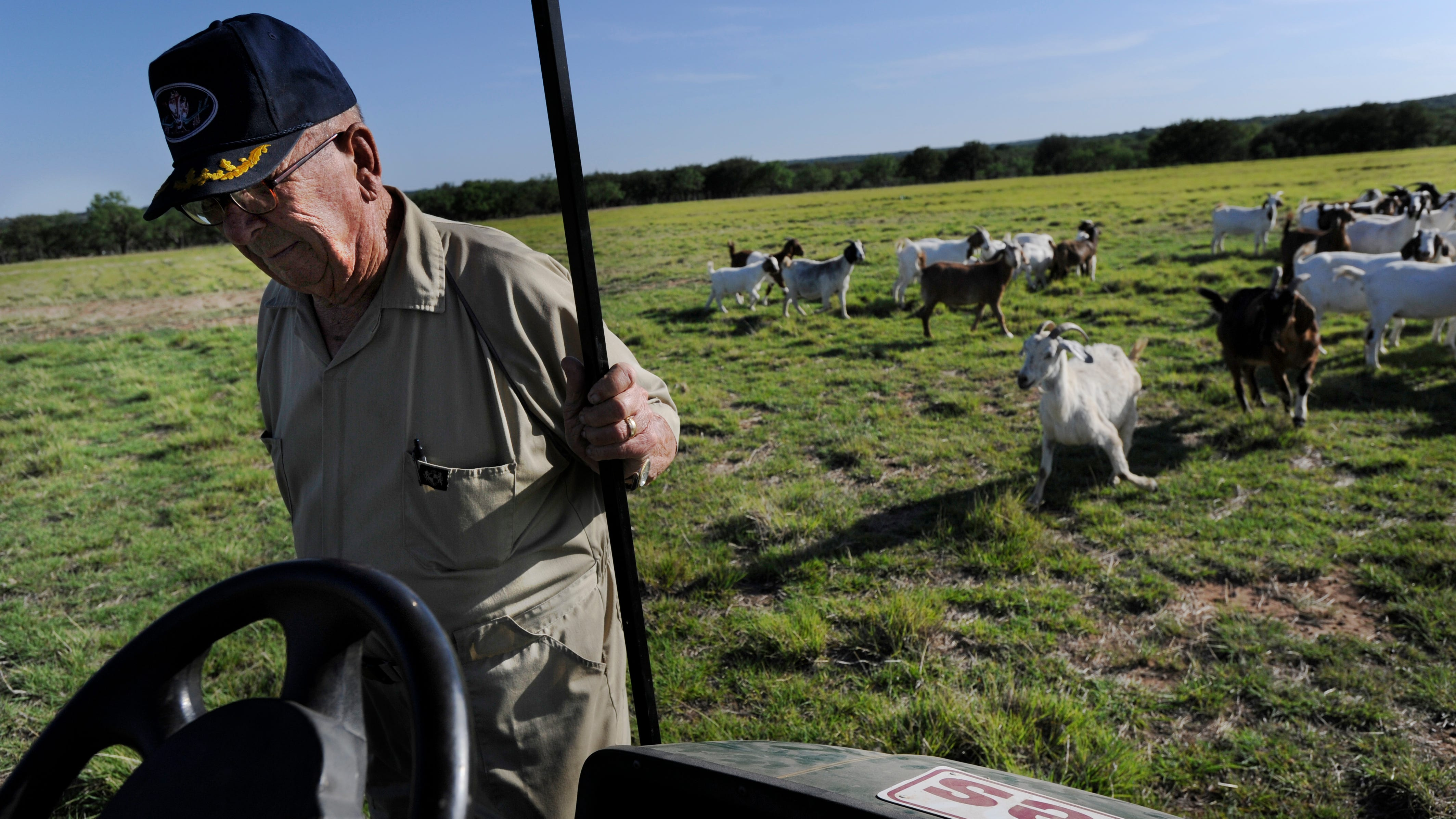 Wes Hays steps into his golf cart after checking on his goats at his Novice ranch Friday May 26, 2011. Hays was awarded the Navy Cross for his service as a naval aviator during World War II.