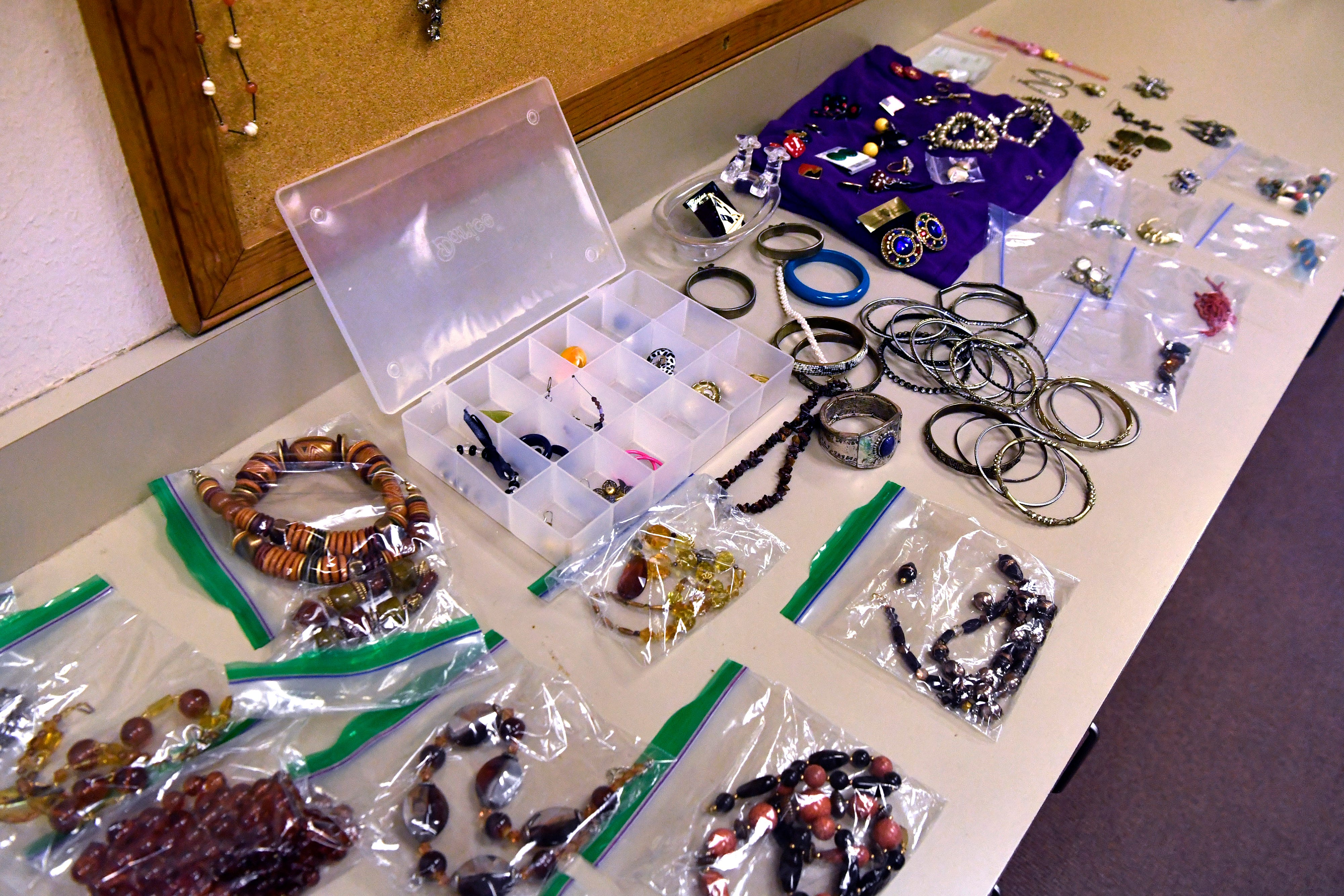 Jewelry is spread on a display counter in the clothes closet at Christian Women's Job Corps of Abilene.