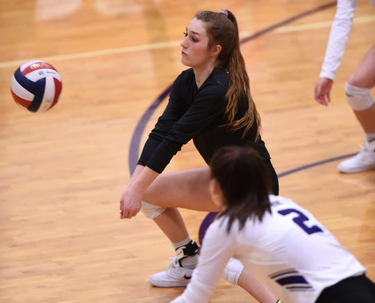 Wylie's Pierson Sanders (1) bends down to return a serve during the Lady Bulldogs' match against Brock at Bulldog Gym on Tuesday, Aug. 28, 2018. The Lady Bulldogs won 3-1.