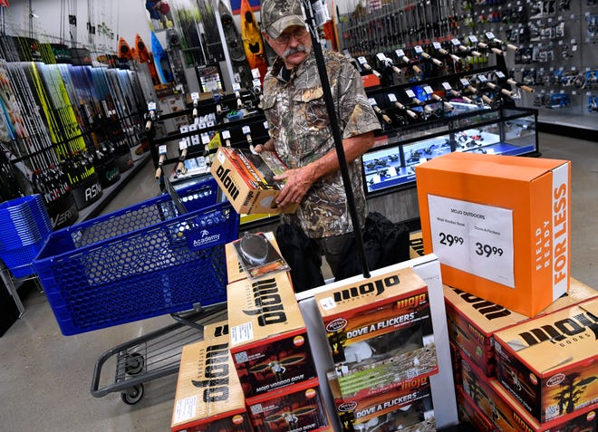 Charlie Brown shops for dove decoys Wednesday at Academy Sports and Outdoors. Dove season begins Saturday.