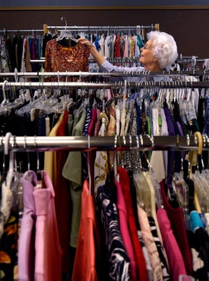 Kay Lee, a volunteer at Christian Women's Job Corps of Abilene, reacts to a dress she found as she sorts garments in the organization's clothes closet August 23, 2018.