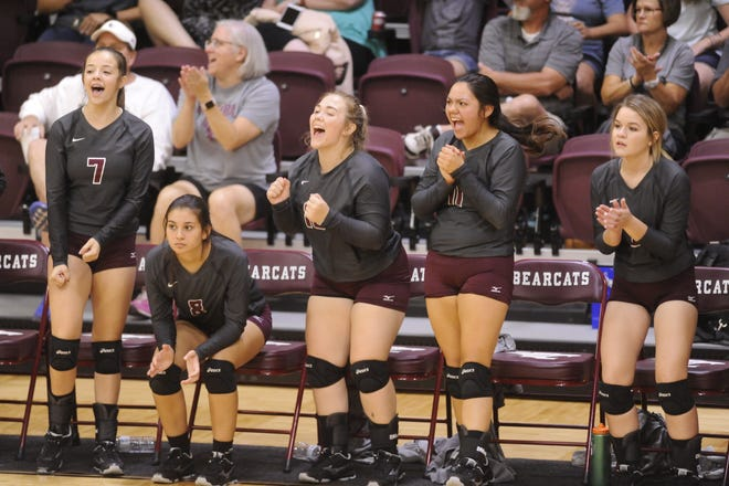 Hawley reserve volleyball players celebrate a point against Breckenridge on Tuesday, Aug. 28 at Bearcat Gym.