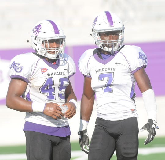 ACU linebacker Qua'Shawn Washington, left, talks to teammate Bolu Onifade, a safety, during the Wildcats' scrimmage Aug. 18 at Wildcat Stadium. Washington will start at linebacker for the Wildcats in Saturday's game against Baylor, after playing running back for the first time in his career last season as a freshman.