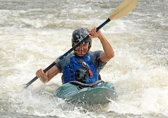 Mike Covey kayaking on Mayo River at Boiling Hole. The N.C. Wildlife Resources Commission encourages everyone to wear a life jacket when out paddling or boating on N.C. waterways.