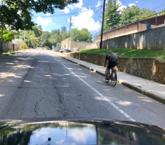 A reader asks if he has to yield to a cyclist in a designated cycling lane while making a right turn.