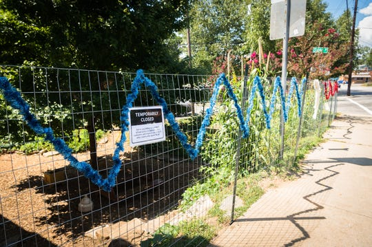 The garden beside Firestorm Bookstore on Haywood Avenue in West Asheville which has been fenced off.