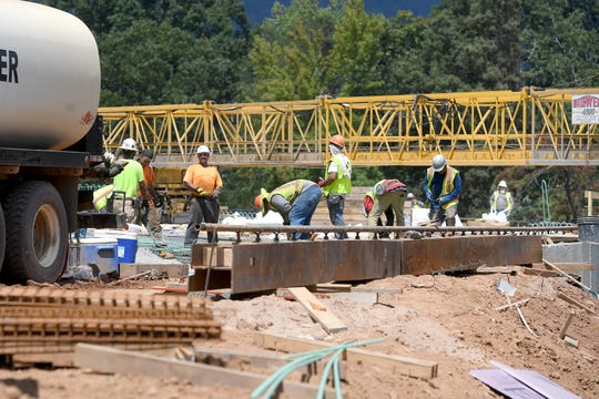 A bridge is worked on at the interchange of I-26 and US-74 near Tryon on Wednesday, Aug. 29, 2018. The project was moved up three years by the North Carolina Department of Transportation because of the scheduled FEI World Equestrian Games and their impact on traffic next month.