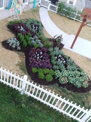 Students from Binghaton University's PwC Scholars program created an accessible flower garden for HCA's Building Blocks Preschool.