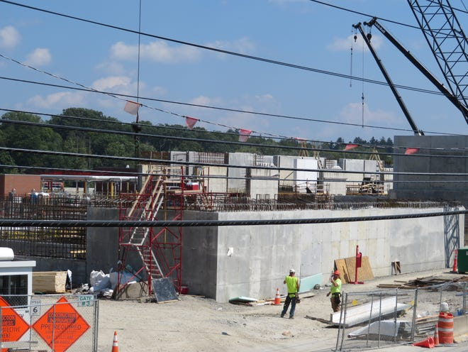 Over four year length of construction of the Binghamton Johnson City Joint Sewage Plant project, 35,000 cubic yards of concrete will have been poured for 20-foot-high holding tanks, 1,000 feet of flood walls and foundations.