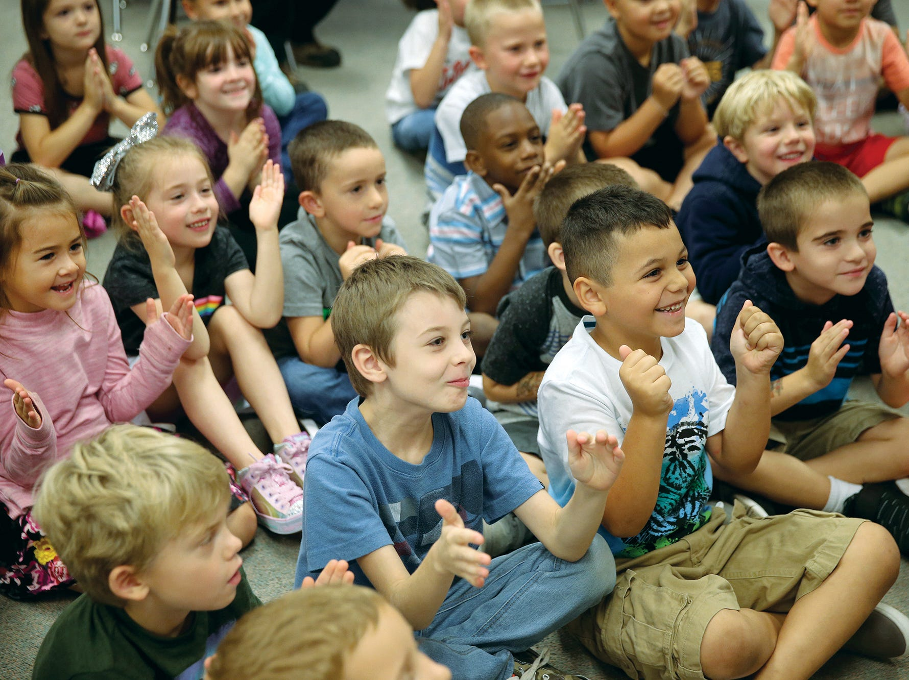 First graders play a clapping game on the first day of school at Kitsap Lake Elementary.