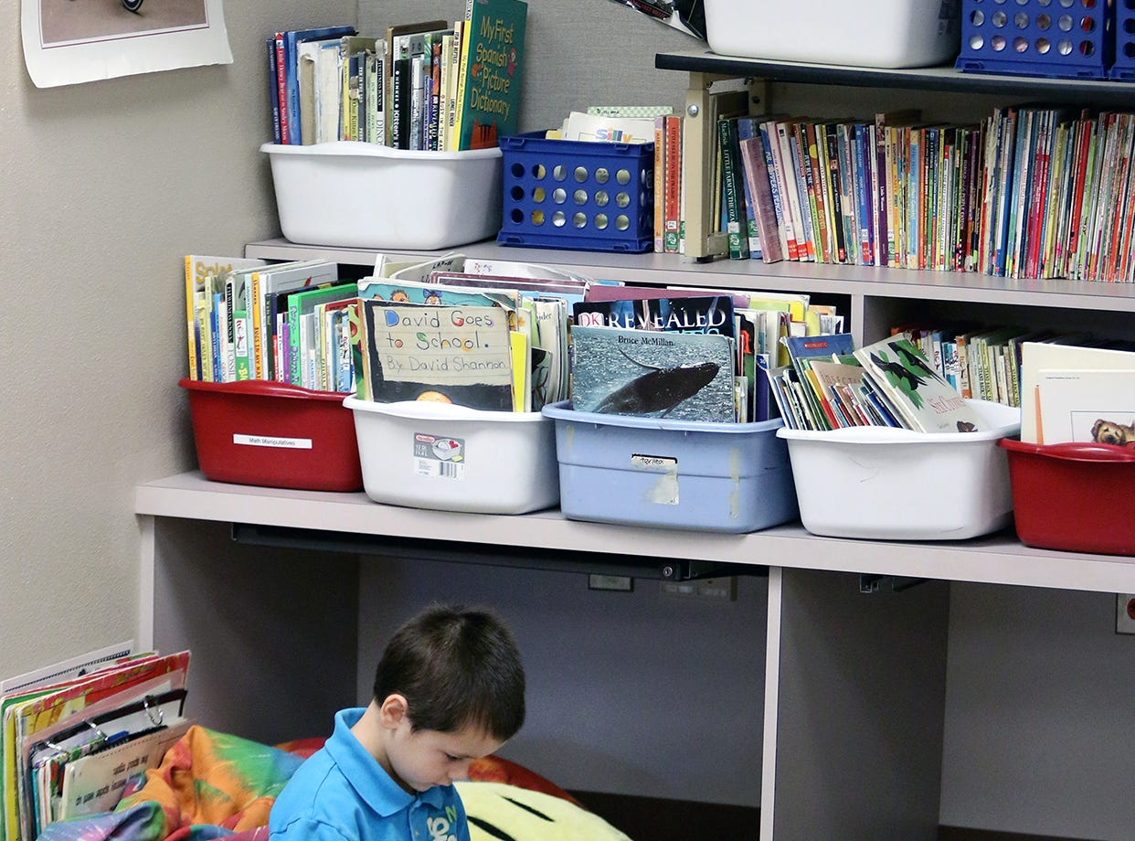 First grader Lucas Bisbee reads a book on the first day of school at Kitsap Lake Elementary on Wednesday.