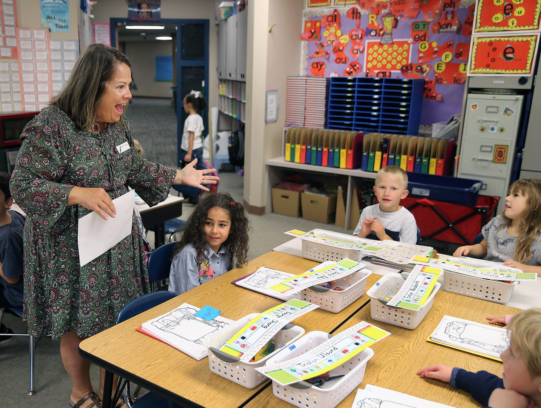 First grade teacher Terri Agius greets students on the first day of school at Kitsap Lake Elementary.