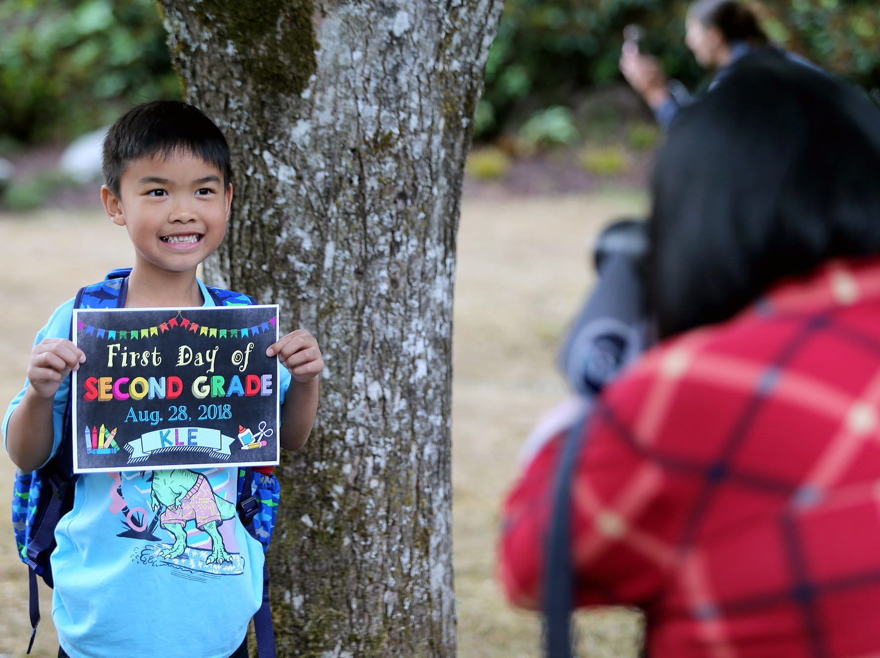 Jayden Aguilar, 7, poses for a photo by his mom, Daisy, on the first day of class at Kitsap Lake Elementary School in Bremerton on Wednesday.