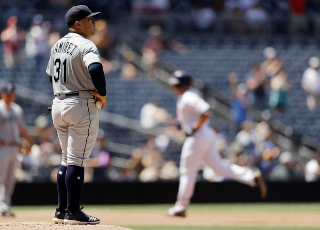 Mariners starting pitcher Erasmo Ramirez, left, looks on as the San Diego Padres' Hunter Renfroe, right, rounds the bases after hitting a three-run home run during the third inning of a baseball game Wednesday.
