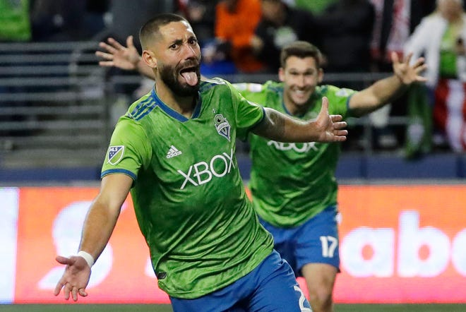 Sounders forward Clint Dempsey celebrates after scoring a goal against Guadalajara during a CONCACAF Champions League match on March 7 in Seattle. Dempsey announced his retirement on Wednesday.