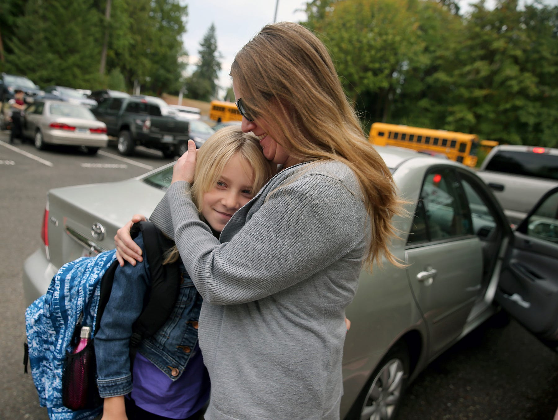 Bethany Blum hugs her fourth-grade daughter Isabella before the first day of class at Kitsap Lake Elementary School.