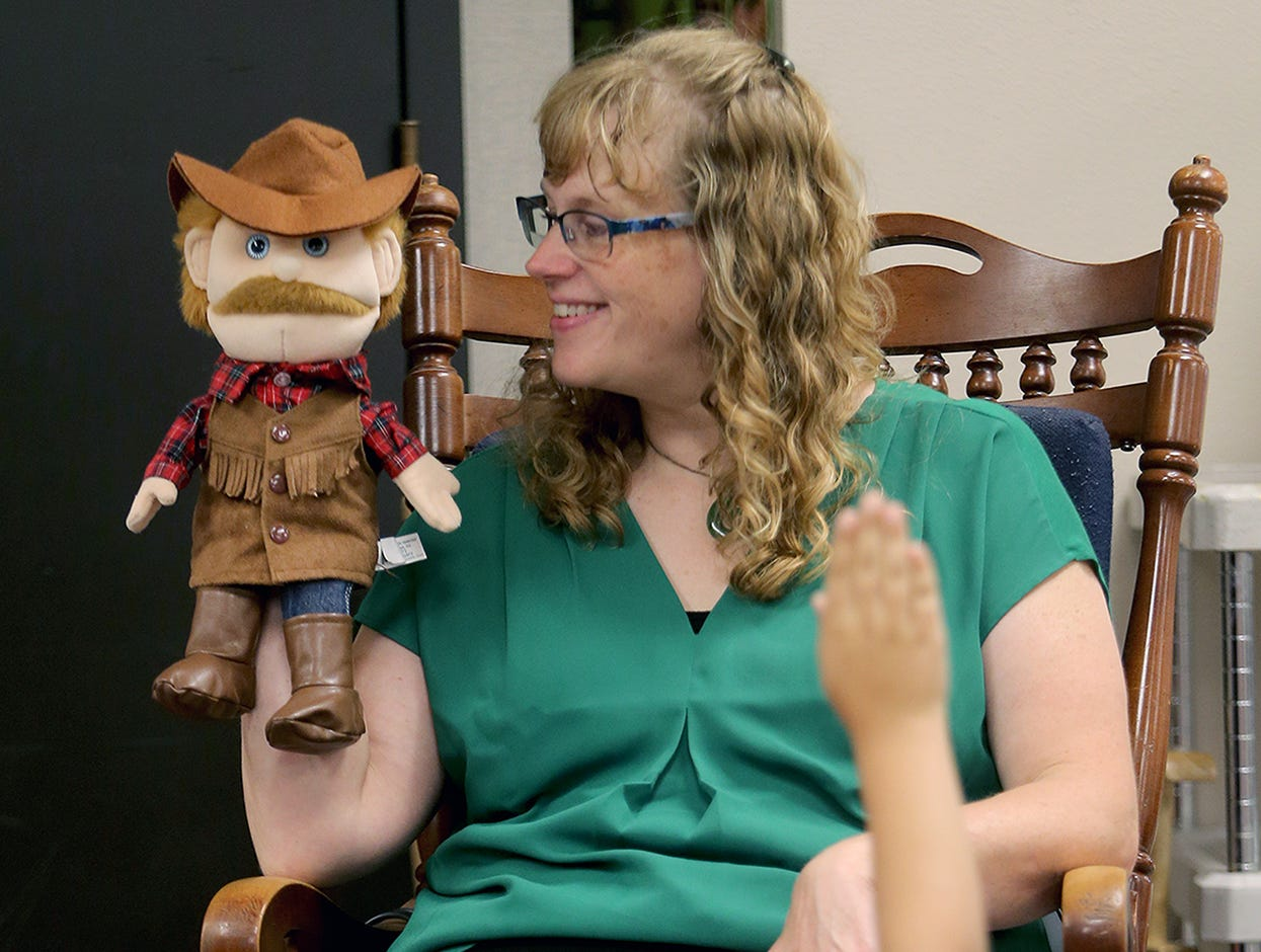 First grade teacher Becky Montgomery uses a puppet to teach a lesson during the first day of class at Kitsap Lake Elementary School on Wednesday.