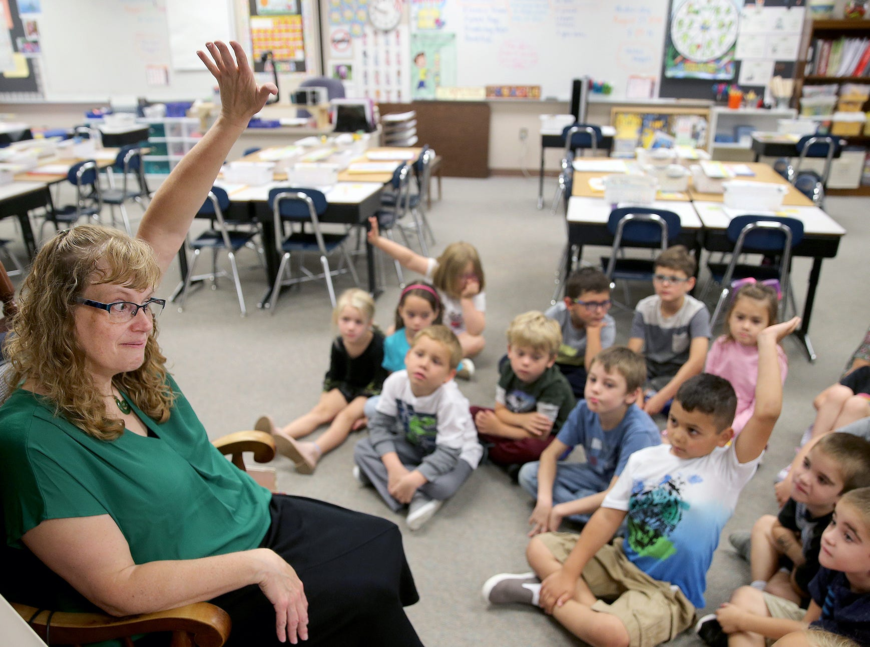 First grade teacher Becky Montgomery encourages students to raise their hands for questions  during class on the first day of school in the Bremerton School District at Kitsap Lake Elementary School on Wednesday, August 29, 2018.