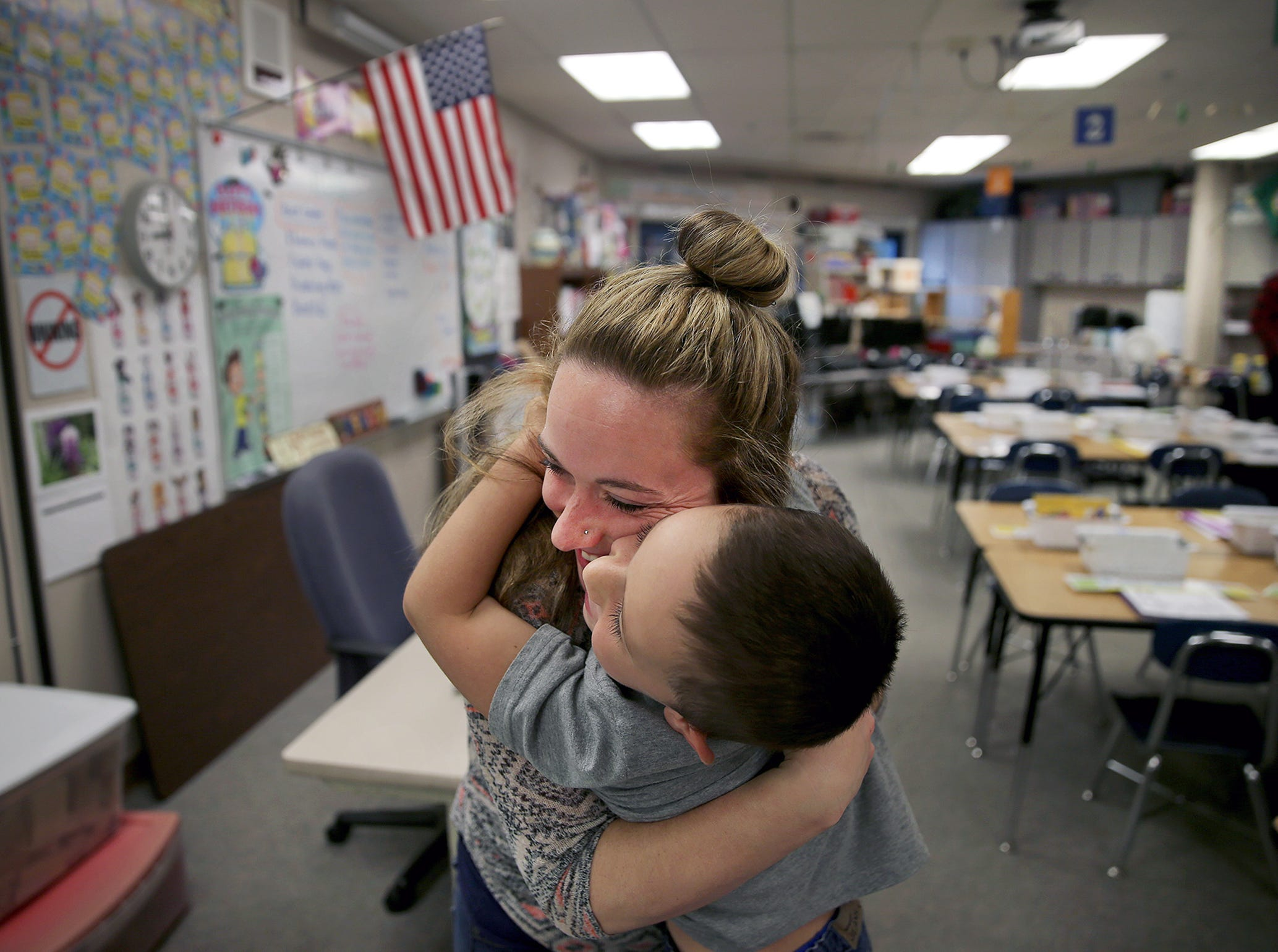 Amanda Rhea hugs her son Carson, 6, as she drops him off for his first day of first grade at Kitsap Lake Elementary on Wednesday. Bremerton School District schools opened Wednesday; the first day of class for other Kitsap and North Mason public schools is Sept. 5.