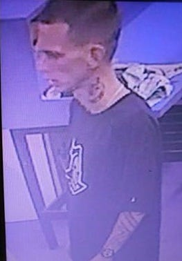 One of the suspects in a laundromat burglary was recorded on a surveillance camera.