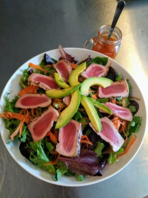 The menu at La Crepe de France in downtown Melbourne includes more than just crepes. This Ahi Tuna Salad as well as quiches and other dishes can be found, too.