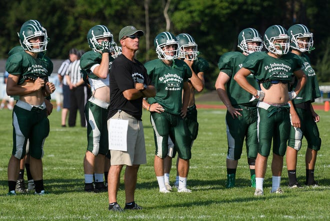 Head coach Rich Alercio and some members of the St. Johnsbury Academy football team watch the action during the scrimmage at Mount Mansfield last week in Jericho.