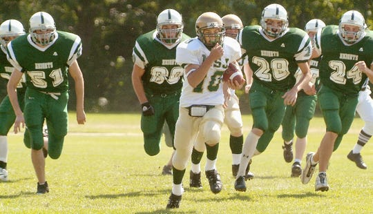 Mount St. Joseph's Will Hadeka, center, returns a kickoff 92 yards for a touchdown against Rice during a 2005 game in South Burlington.