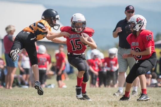 A Chittenden South player runs with the ball during the youth football jamboree at the Palmer Field on Aug. 25 in Hinesburg.