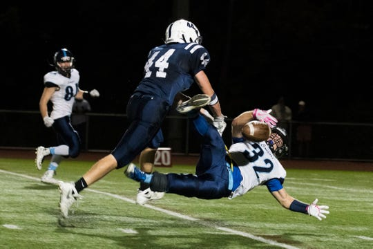 MMU's Raymond Wilson (32) attempts to catch a pass during the high school football game between the Mount Mansfield Cougars and the Burlington Seahorses at Buck Hard Field on Friday night September 30, 2016 in Burlington.