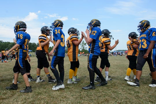 Players from St. Albans and Essex shake hands at the conclusion of a game during the youth football jamboree at the Palmer Field on Saturday afternoon August 25, 2018 in Hinesburg.