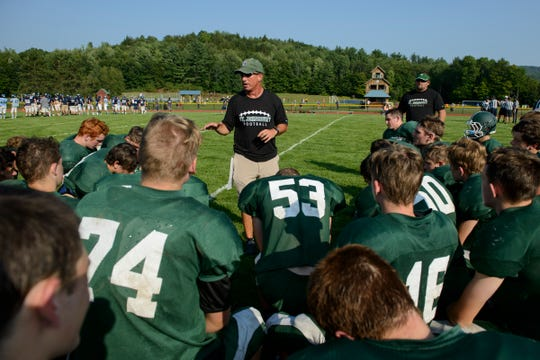 St. Johnsbury head coach Rich Alercio talks to the players during the boys football scrimmage game between the St. Johnsbury Hilltoppers and the Mount Mansfield Cougars at MMU high school on Friday afternoon August 24, 2018 in Jericho.
