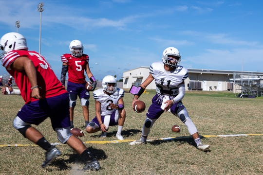 Aransas Pass quarterbacks and running backs run plays during practice on Tuesday, Aug. 28, 2018 ahead of Fridays game against Rockport-Fulton. In 2017 Aransas Pass and Rockport-Fulton's game was canceled do to Hurricane Harvey.