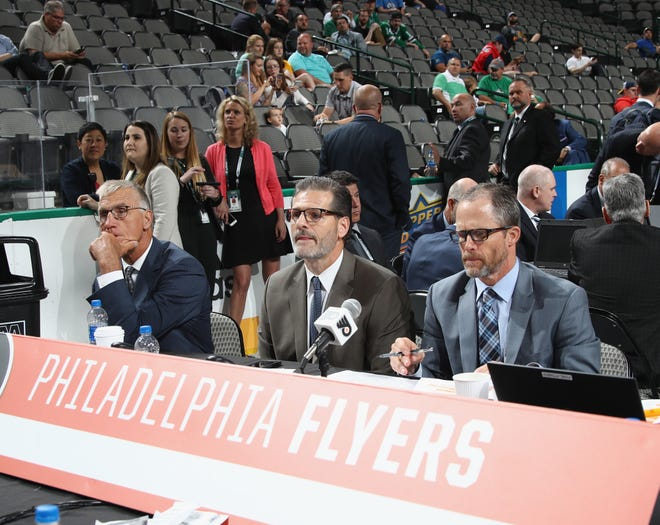 Flyers general manager Ron Hextall, center, has worked with team president Paul Holmgren, left, and assistant GM Chris Pryor, right, to rebuild the team.