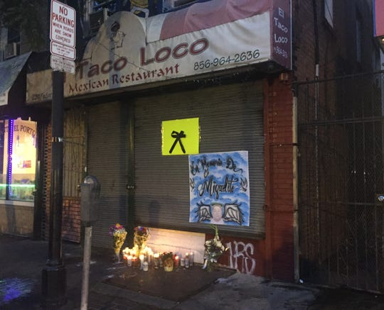 Candles flicker at a memorial to Camden murder victim Miguel Rodriguez-Zavala, who operated El Taco Loco, shortly after his August 2018 slaying.