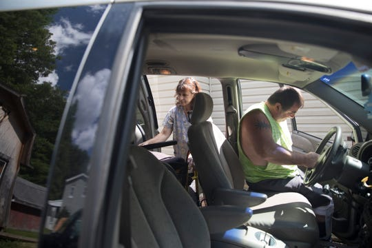 Robin Robinson loads James' wheelchair into his van at the end of the day so he can drive to the store. While the aide is not allowed to ride with a patient, they can still assist getting in and out of the vehicle.