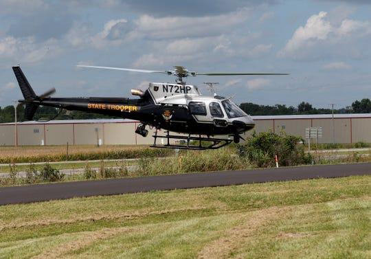 An Ohio Highway Patrol helicopter takes off from near the agency's Chillicothe post Wednesday, Aug. 29, 2018, in Chillicothe.