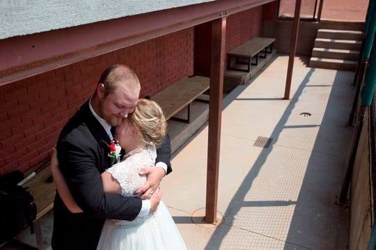 """Kristopher Weisheit and Brittany Birk took their vows Aug. 25, 2018, from home plate at League Stadium, which is featured in the 1992 movie """"A League of Their Own."""""""