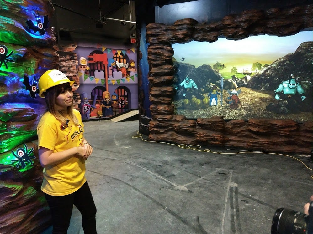 Jenna Maffei, marketing manager of LEGOLAND Discovery Center Columbus, talks Wednesday about the Kingdom Quest ride at the center.