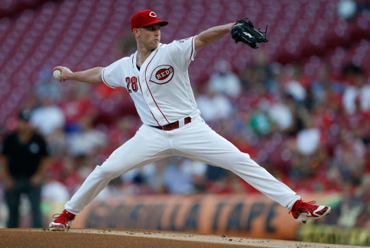 Cincinnati Reds starting pitcher Anthony DeSclafani (28) throws against the Milwaukee Brewers during the first inning of a baseball game, Tuesday, Aug. 28, 2018, in Cincinnati.